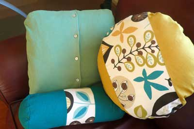 Upcycled sweater pillow with other accent pillows.